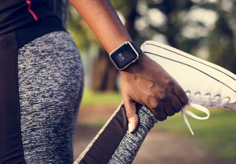 People stretching in a park - Benefits in Wearable Technology