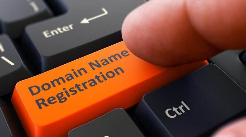 Finger Presses the Button Domain Name Registration on Black Keyboard - How to Register a Domain Name?